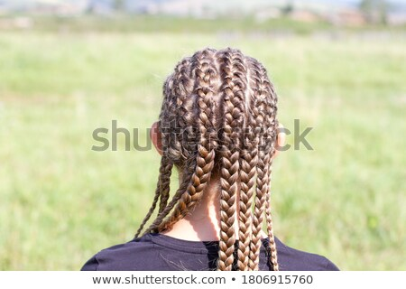 Girl with many small braids Stock photo © svetography