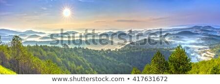 morning mist over a mountain village stock photo © kotenko
