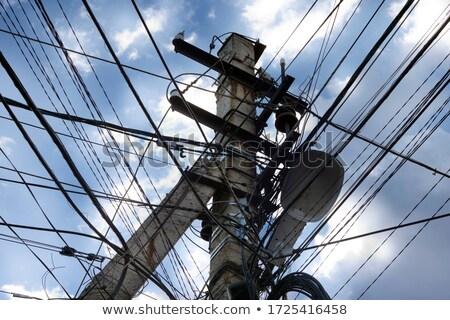 Drót kábelek rendetlen elektromosság pólus város Stock fotó © FrameAngel