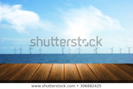 3D background of a wooden table looking out to a wind farm in th Stock photo © kjpargeter