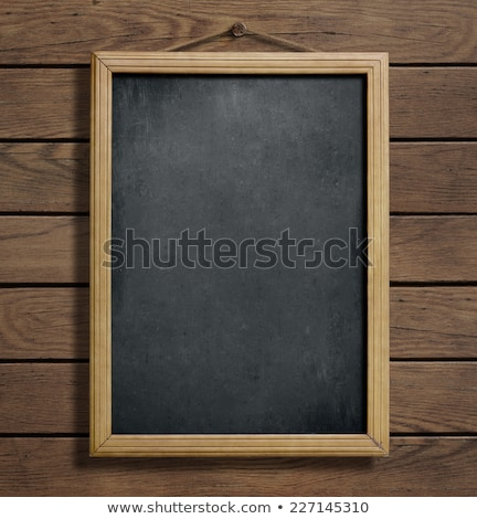 chalk marks on dirty school blackboard with wooden frame stock photo © stevanovicigor