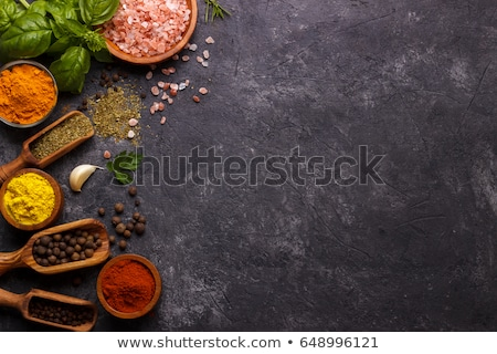 Rustic spoons on slate stone background  Stock photo © tab62