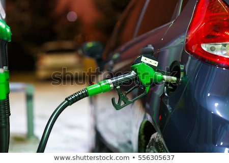 Car refueling on a petrol station in winter at night Stock photo © vlad_star