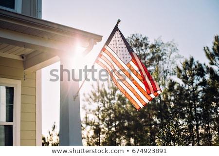 Amerykańską flagę domu wiszący maszt front pionowy Zdjęcia stock © iofoto