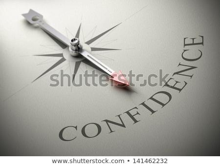 Kompas igły wskazując słowo zaufania boga Zdjęcia stock © Zerbor