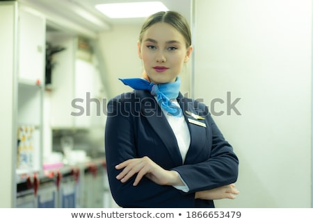 caucasian stewardess standing with folded arms stock photo © rastudio