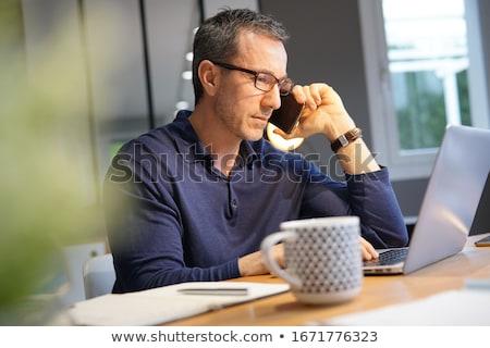Jóképű fiatalember dolgozik otthoni iroda okostelefon modern Stock fotó © vlad_star