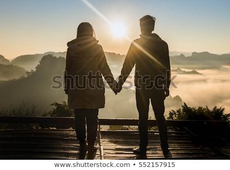 Couple amoureux ciel pier coucher du soleil Photo stock © alphaspirit
