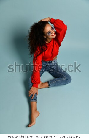 young woman with windy hair sitting on floor Stock photo © julenochek
