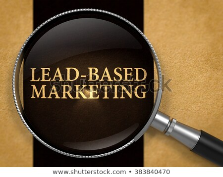 Lead-Based Marketing through Loupe on Old Paper. Stock photo © tashatuvango