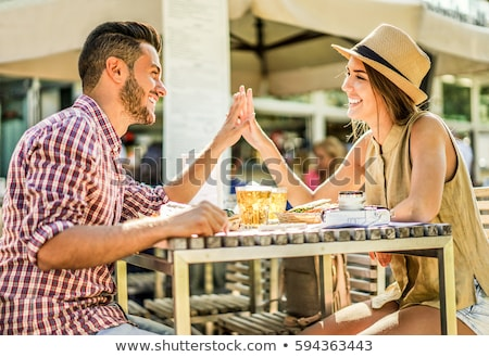 Happy couple having tender moments in bar restaurant - Young tra Stock photo © DisobeyArt