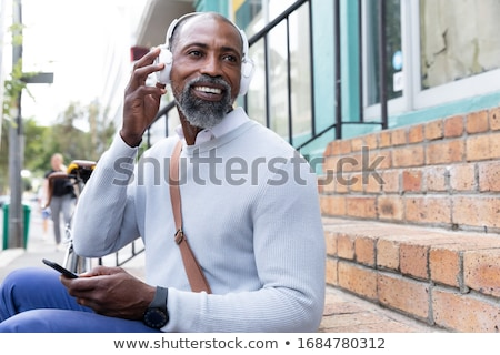Man next to bicycle, headphones on Stock photo © IS2