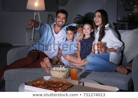 happy man with popcorn watching tv at night Stock photo © dolgachov