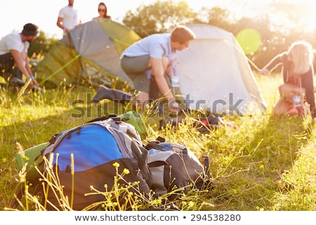 couple at a festival backpacking tents stock photo © is2