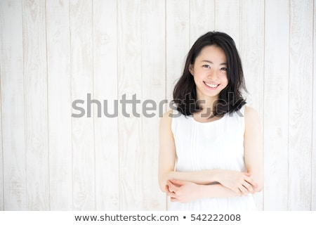 portrait of a smiling happy asian woman stock photo © deandrobot