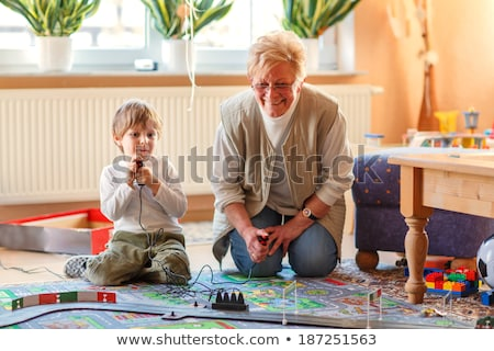 A grandmother playing with two toddlers Stock photo © IS2