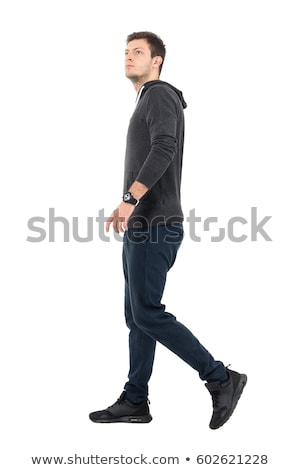 relaxed casual man walking and looking to side Stock photo © feedough