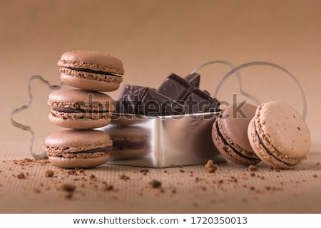 Luxury chocolate candies with hazelnuts and white cream with coconut flake round candies on marble c Stock photo © DenisMArt