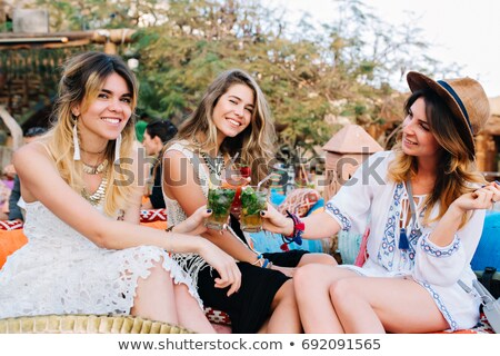 Happy young friends outdoors in park having fun posing drinking soda take a selfie by phone. Stock photo © deandrobot