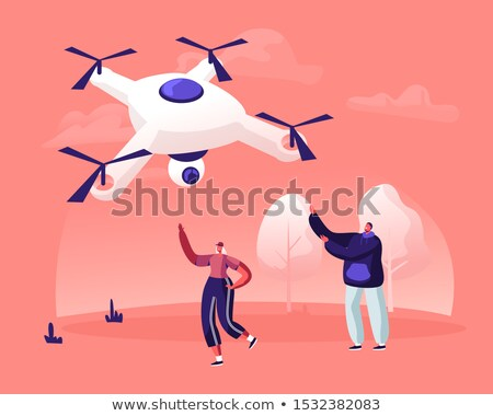 woman flying a drone in rural landscape stock photo © lovleah