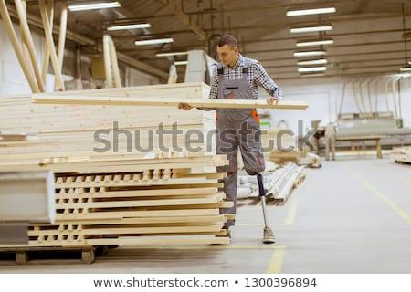 無効になって 若い男 人工的な 脚 作業 家具 ストックフォト © boggy