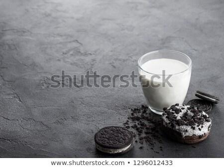 Vetro latte nero sandwich cookies ciambella Foto d'archivio © DenisMArt