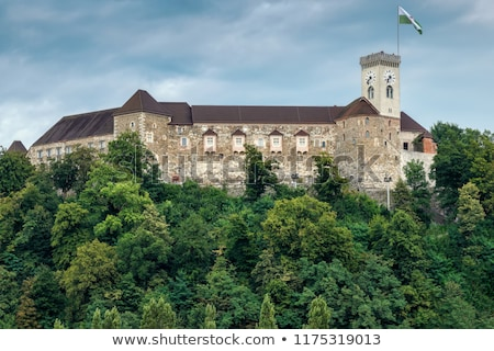 Clock tower of Ljubljana castle with town flag in Slovenia Stock photo © boggy
