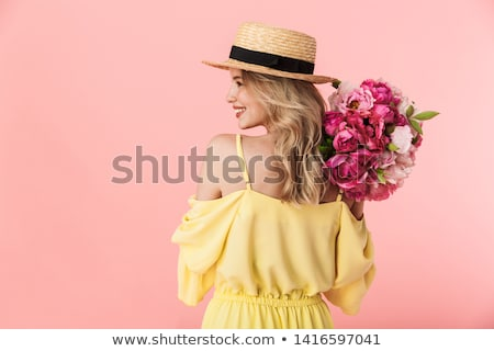 pretty happy young woman posing isolated over pink wall background holding lipstick stock photo © deandrobot