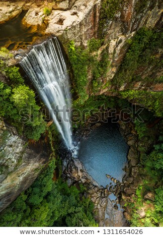 Waterfall tumbling over the sheer cliffs to idyllic waterhole Stock photo © lovleah