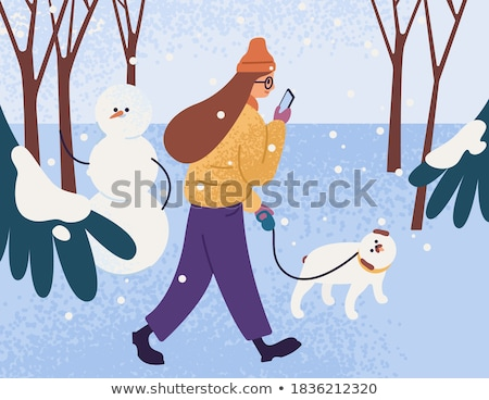 Woman Walking Dog on Leash in Snowfall Wintertime Stock photo © robuart