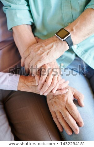 Overview of hands of retired spouses in casualwear Stock photo © pressmaster