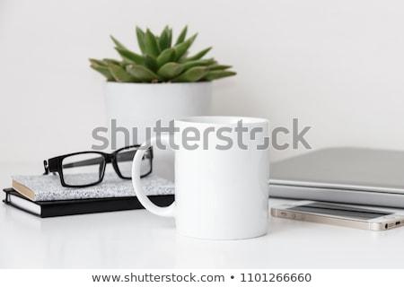 Kávéscsésze szemüveg asztal közelkép notebook iroda Stock fotó © stoonn