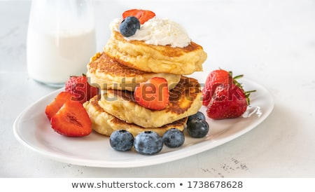 Portion of ricotta fritters with fresh berries ストックフォト © Alex9500
