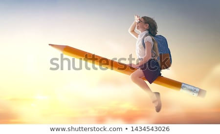 child flying on a pencil Stock photo © choreograph