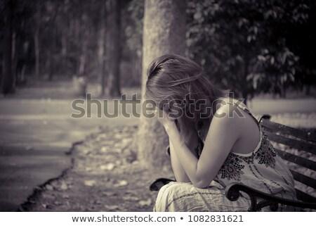 Aranyos fiatal nő megnyugtató fából készült pad kert Stock fotó © Giulio_Fornasar
