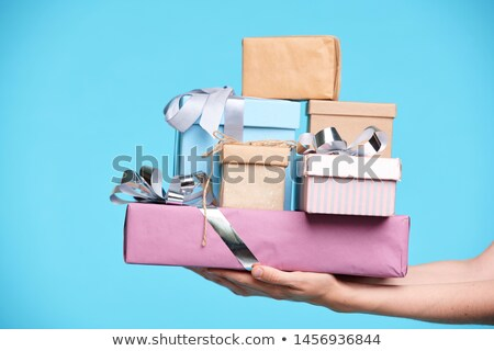 Stack of packed and wrapped presents in boxes held by female hands Stock photo © pressmaster