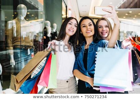 female friends taking selfie at clothing store stock photo © dolgachov