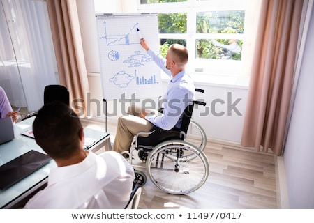 Disabled Businessman Giving Presentation To His Colleague Stock photo © AndreyPopov