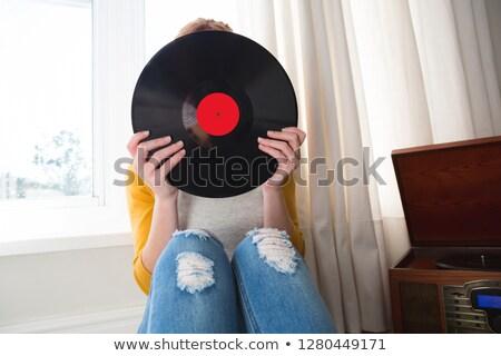 Femme cacher visage vinyle record maison Photo stock © wavebreak_media