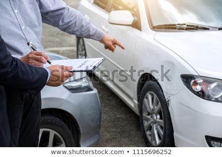 Loss Adjuster Filing The Report Claim Form After Accident Stock photo © AndreyPopov
