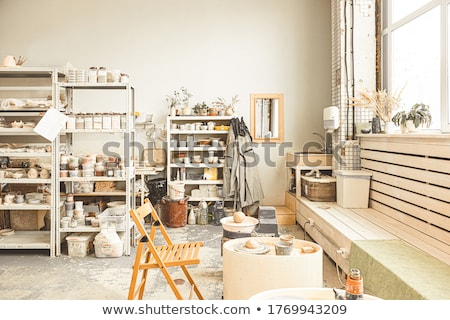 Cups on the shelves in the pottery workshop Stock photo © galitskaya