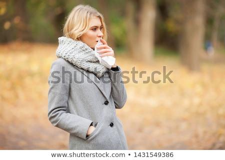 Nő orrot fúj papírzsebkendő kint csinos fiatal nő Stock fotó © AndreyPopov