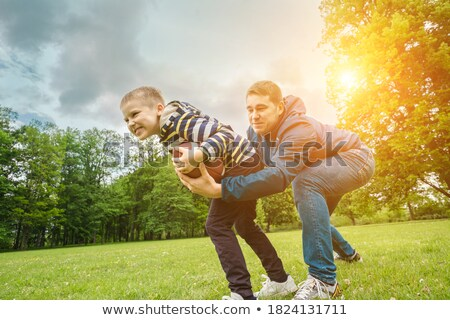 Child outdoor in a public Park on the grass running with a slice of watermelon Stock photo © ElenaBatkova
