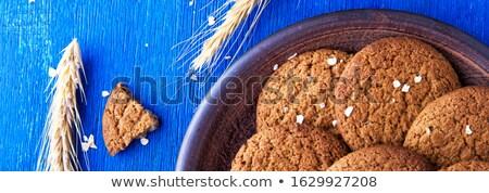 Szalag kása sütik barna tányér kék Stock fotó © Illia