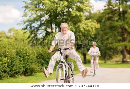 Fietsen zomer park ouderdom mensen Stockfoto © dolgachov
