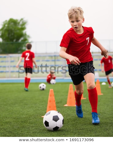 Soccer Boy on Training with Ball and Soccer Cones. Dribbling Dri Stock photo © matimix