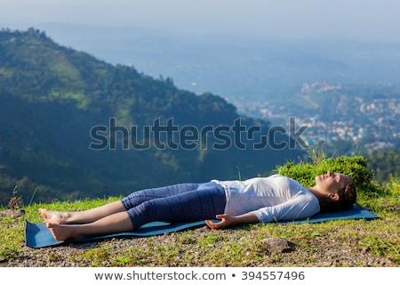 Nő jóga kint pihenés holttest póz Stock fotó © dmitry_rukhlenko