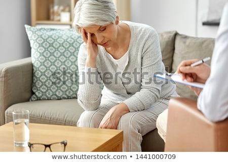 sad senior woman patient and psychologist Stock photo © dolgachov