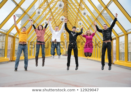 group of friends jump on footbridge Stock photo © Paha_L