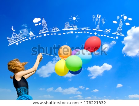 redhead girl with colour balloons at blue sky background stock photo © massonforstock
